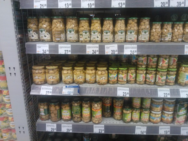 The assortment of pickled mushrooms in Kiev supermarkets of products Ukrainian, Polish and Chinese manufacturers